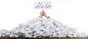 buried-under-paperwork-600x265
